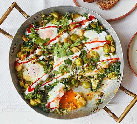 Sprout & spinach baked eggs served in a pan