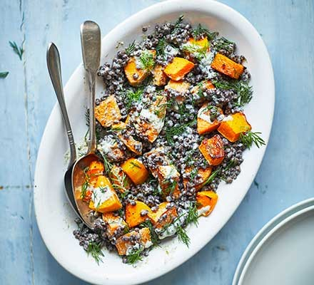 A dish serving squash & lentil salad