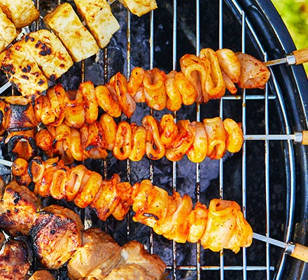 squid and prawn skewers on a barbecue