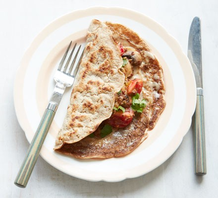 Staffordshire oatcakes on a plate with mushroom and tahini filling