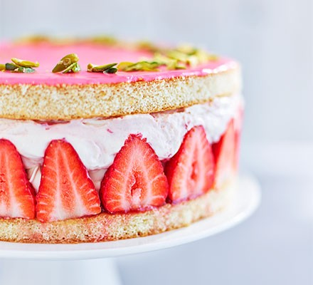 Strawberry & elderflower gateau served on a cake stand