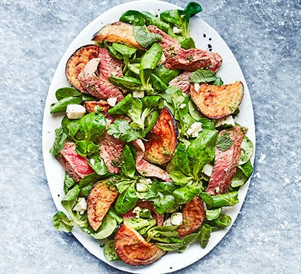 Steak & aubergine salad served on an oval plate