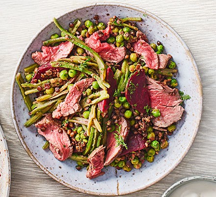 Steak, beetroot, horseradish & warm lentil salad served on a plate
