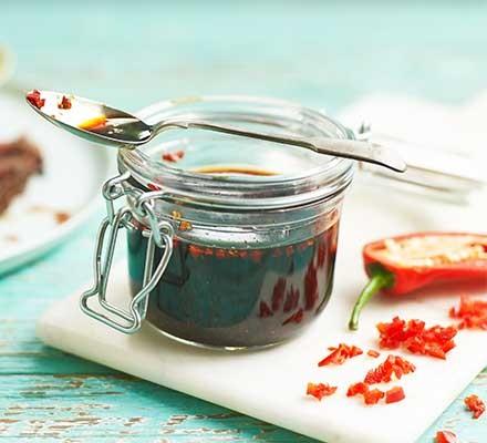 A jar filled with steak marinade