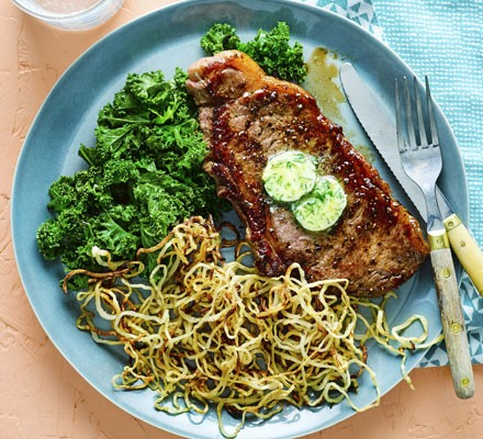 Steak with rosemary celeriac fries, kale & garlic butter