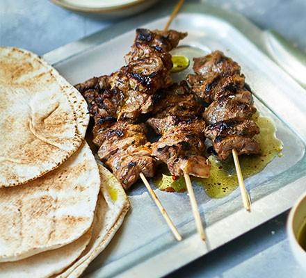 Sticky jerk lamb kebabs served with flatbreads