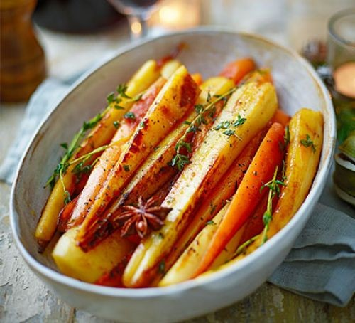 Bowl of roasted root vegetables glazed in maple syrup