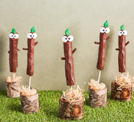 Chocolate sticks with eyes on wooden bases