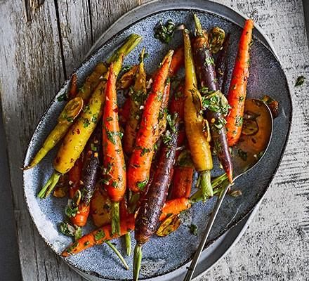 Stir-fried cumin carrots served in a decorative dish