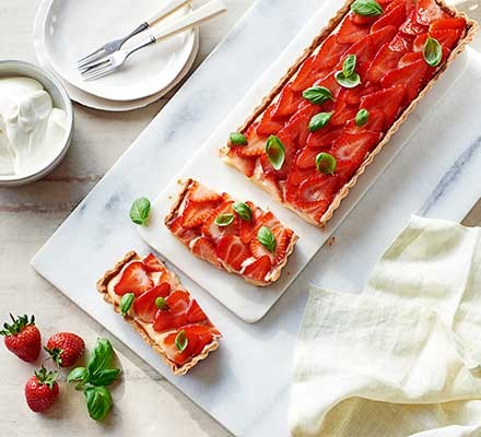 A plate serving strawberry & basil tart