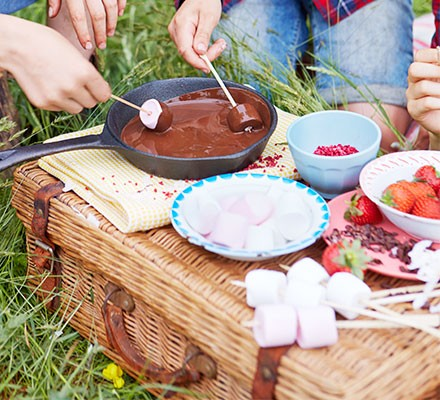 Strawberry, chocolate & marshmallow dippers served on a wicker picnic basket