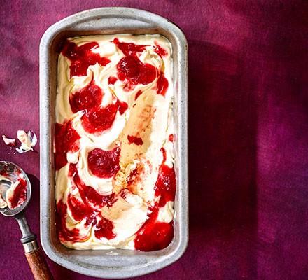 Strawberry jam ripple ice cream in an ice-cream tub