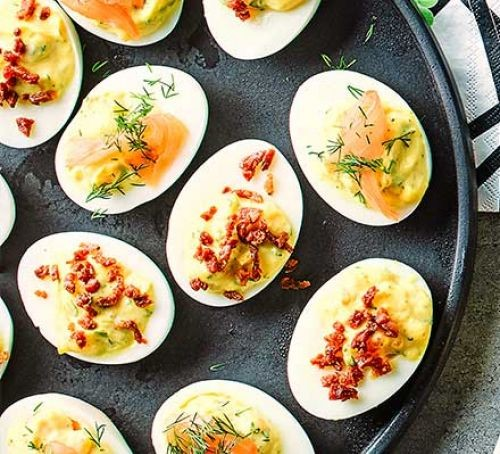 egg canapes with smoked salmon and chorizo on a platter