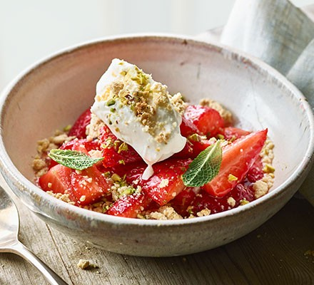 Sugar-cured strawberries & white chocolate crumble served in a bowl