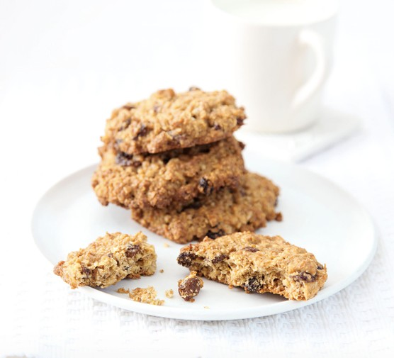 Stack of sultana and oat cookies on a white plate