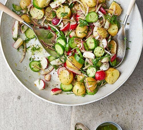 Summer allotment salad with new potatoes and vegetables in a bowl