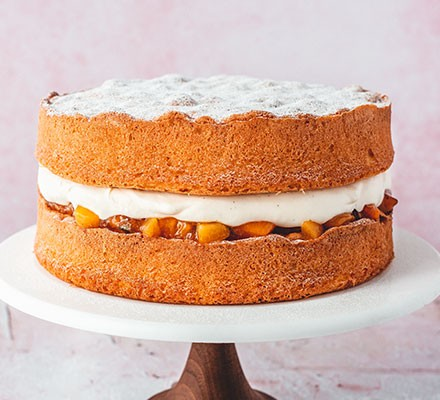 Summer apricot Victoria sponge on a cake stand