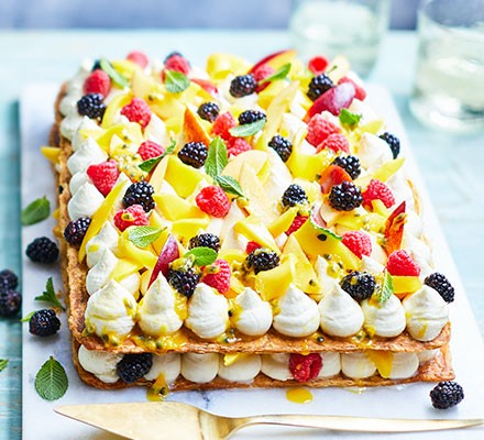Summer fruit & mascarpone tart served on a cutting board
