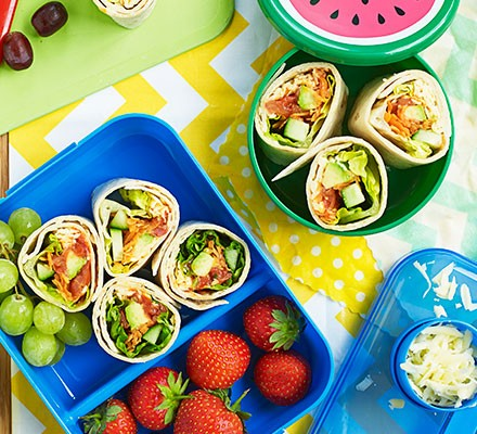 Super-salad wraps served in a lunchbox alongside fruit