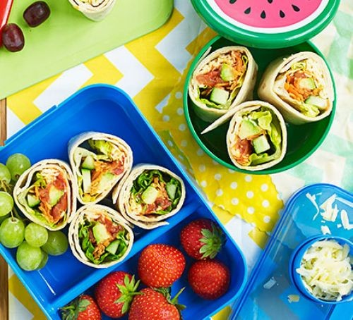 Salad wraps and fruit in blue lunchboxes