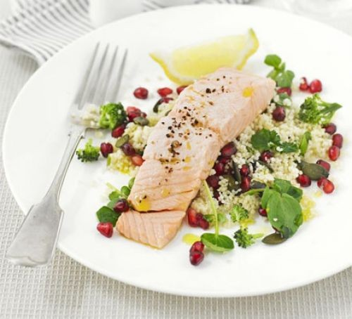 Salmon fillet on a bed of salad on a plate