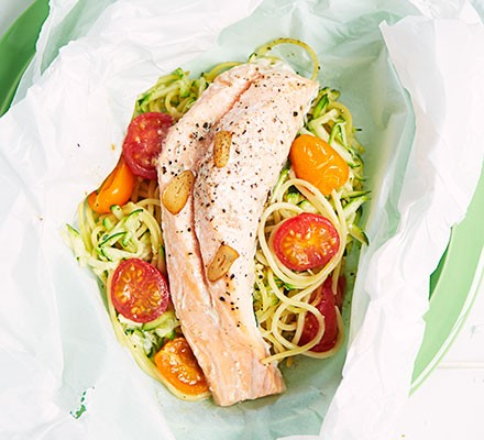 An open parcel revealing salmon on a bed of noodles