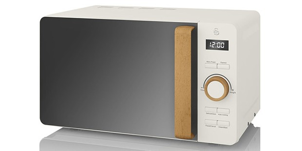 Swan Nordic digital microwave on a white background