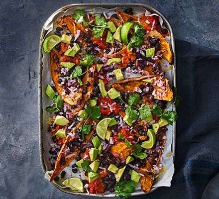 Sweet potato nachos with avocadoes and tomato salsa