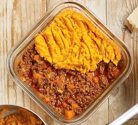 A casserole dish serving sweet potato-topped cottage pie