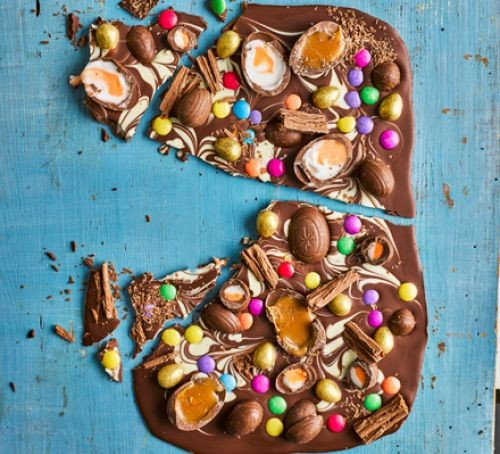 Chocolate bark with sweets and creme eggs on top
