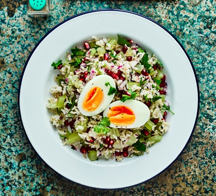 Tabbouleh salad in bowl topped with hard boiled egg