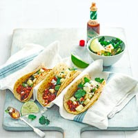 Tacos with hot sauce and toppings