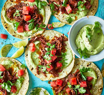 Barbacoa beef tacos served with pickled watermelon & avocado sauce