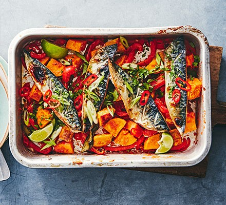 Thai mackerel & sweet potato traybake served in a roasting dish