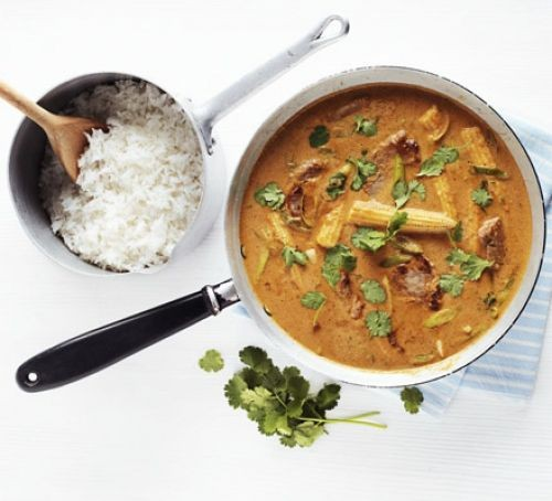 Pork curry in a saucepan with rice