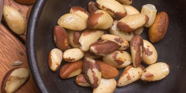 Brazil nuts in black bowl