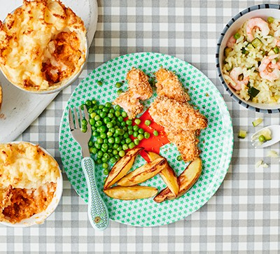 Salmon fingers, peas and wedges with shepherd's pie and prawn risotto