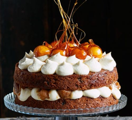 Toffee apple cake with cream, topped with toffee apples