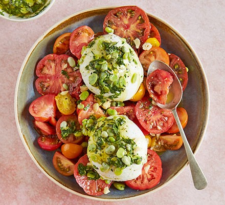 Tomato, burrata & broad bean salad served in a large bowl