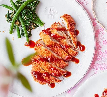 Japanese Tonkatsu pork served on a plate with greens