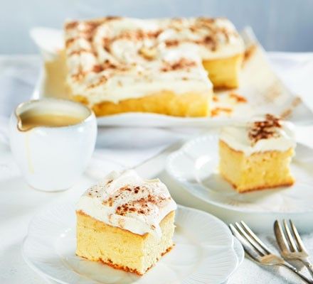 Cake with cream and caramel on plate