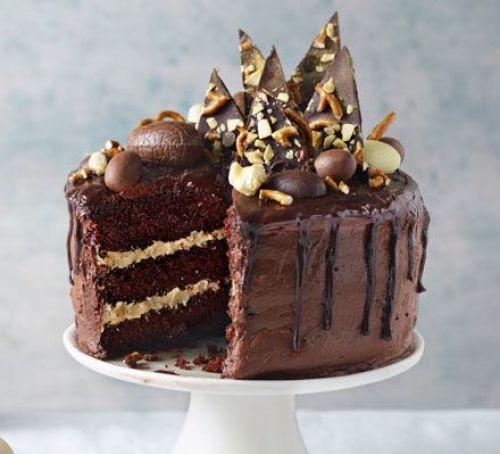 Chocolate cake topped with chocolate shards and eggs
