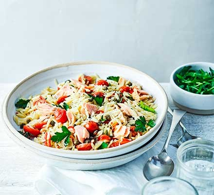 A bowl serving tuna & caper orzo with parsley