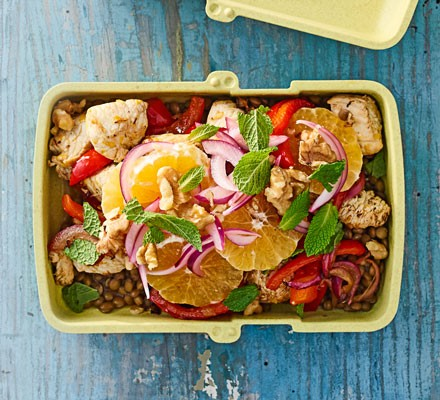 A lunchbox filled with lentil, turkey and clementine salad