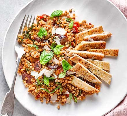 Turkey escalopes & giant couscous served on a plate