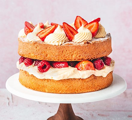 Ultimate traditional Victoria sponge on a cake stand