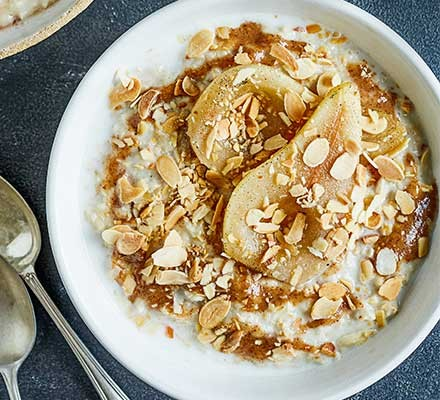 Porridge topped with vanilla poached pears with almond butter