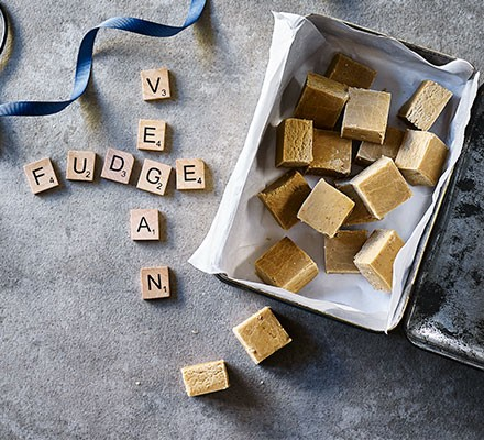 Vanilla vegan fudge cut into pieces and served in a tin