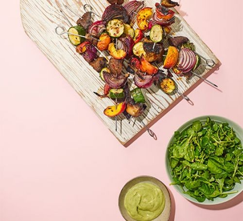 Vegan kebabs on a board with dips