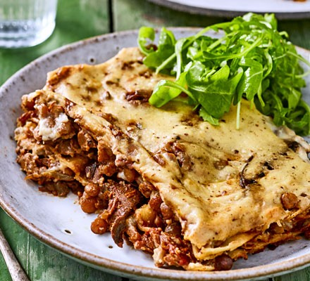 Lasagne on plate with salad